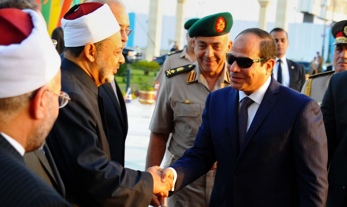 IN THIS PICTURE PROVIDED BY THE OFFICE OF THE EGYPTIAN PRESIDENCY, EGYPTIAN PRESIDENT ABDEL-FATTAH EL-SISSI, RIGHT, SHAKES HANDS WITH SHEIK AHMED EL-TAYEB, GRAND IMAM OF AL-AZHAR, OUTSIDE THE FIELD MARSHAL HUSSEIN TANTAWI MOSQUE