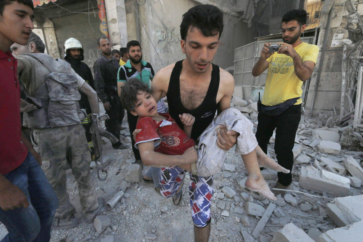 Hosam Katan/Reuters A man carries an injured child after what activists said were barrel bombs were dropped by forces of Syria's President Bashar Al-Assad in Aleppo's al-Saliheen district, on Friday. MPC Journal, Hakim Khatib