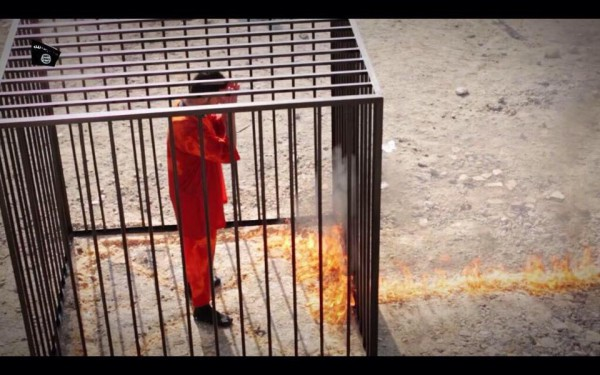 The Jordanian pilot Moaz Al-Kasasba is set on fire while surrounded by IS militants