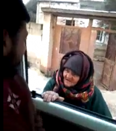 Old Woman Talking to IS militants
