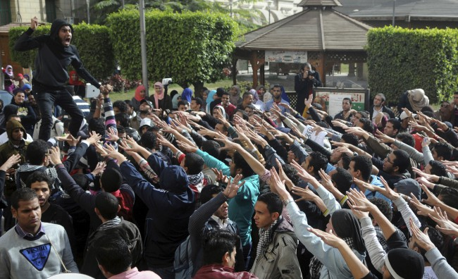 Cairo University students supporting the Muslim Brotherhood and deposed President Mohamed Mursi shout slogans at the university's campus in Cairo, MPC Journal