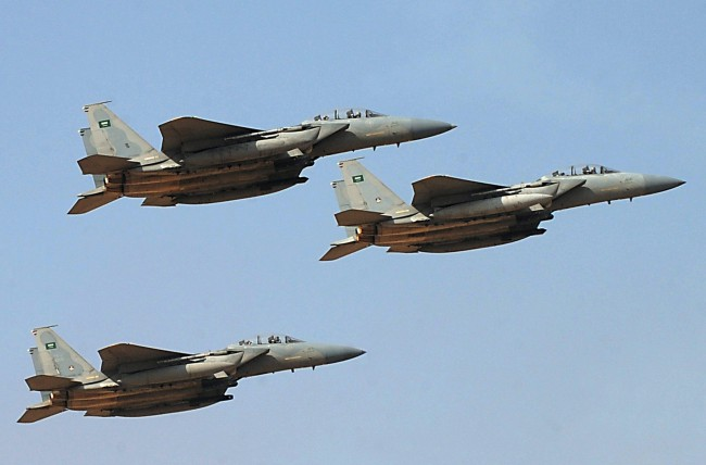 © Image: AFP/ Fayez Nureldine - A file picture shows jet fighters of the Saudi Royal air force performing. The picture was taken on January 1, 2013