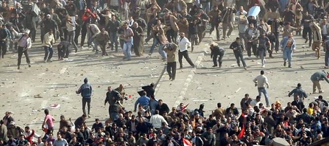 Clashes between pro-Mubarak and anti-Mubarak in Tahrir Square.
