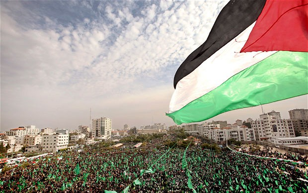 MPC Journal Thousands of Gazans gather during a rally to mark the 24th anniversary of Hamas - © Image: EPA.