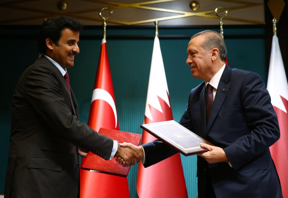 Emir of Qatar Sheikh Tamim bin Hamad bin Khalifa Al Thani (L) and Turkish President Recep Tayyip Erdogan (R) in Ankara, Turkey on 19 December, 2014 (AA) - MPC Journal