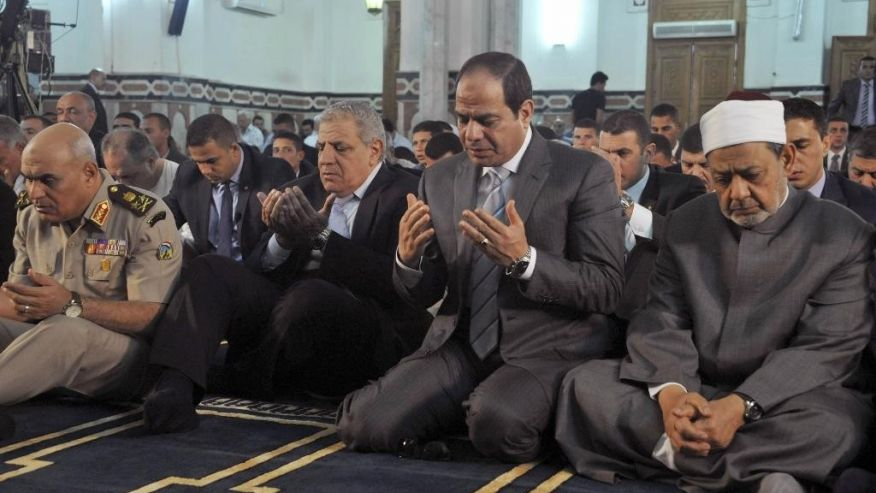 In this Oct. 4, 2014 file photo released by Egypt's official Middle East News Agency (MENA) shows Egyptian President Abdel-Fattah el-Sissi, second right, the Grand Sheik of Al-Azhar, Ahmed el-Tayeb, right, Prime Minister Ibrahim Mehleb, center,