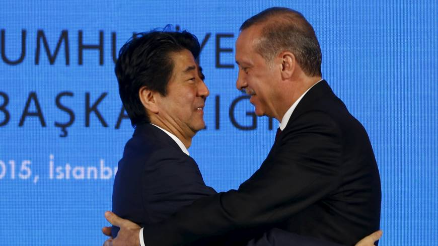 Turkish President Recep Tayyip Erdogan hugs Prime Minister Shinzo Abe after a news conference in Istanbul on Saturday. | REUTERS - MPC Journal