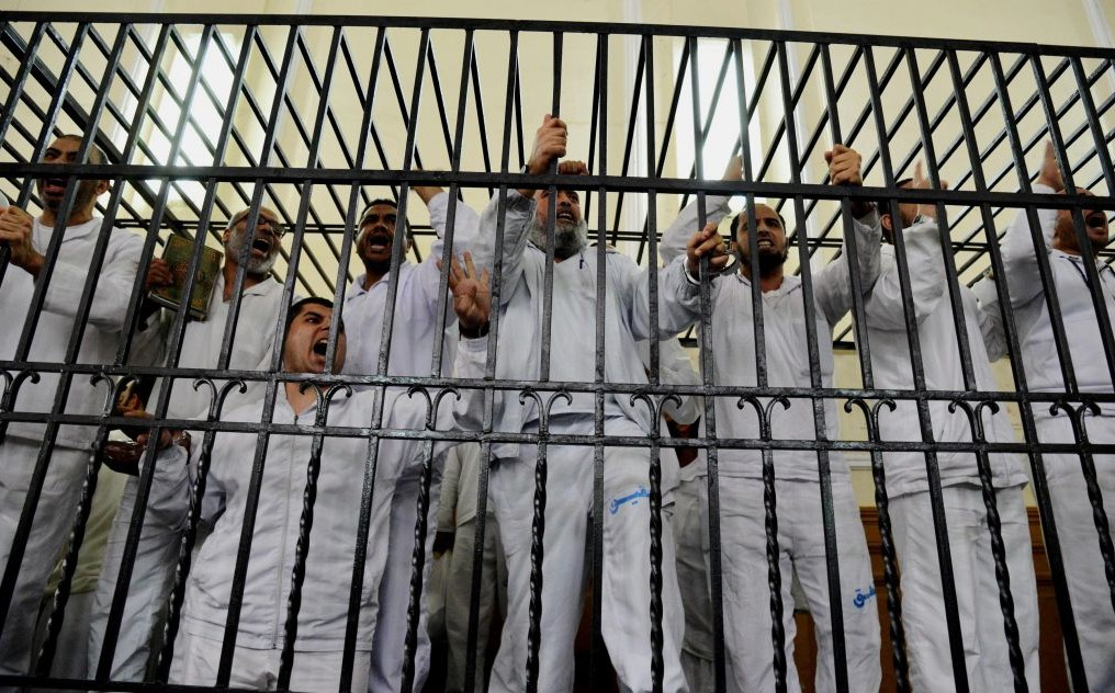 Mideast-Egypt_Hoo-e1402148827302 - MPC Journal - Egypt Sentences Six to Death and Morsi to Life Prison in Qatar Spying Case