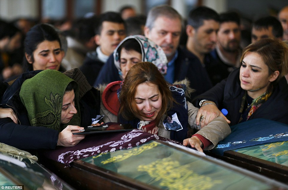 How Radical Ideologies Thrive in Divided World - A woman cries over the coffin of a suicide bombing victim during a commemoration ceremony in a mosque in Ankara, Turkey