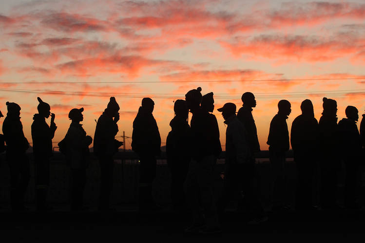 Some of the thousands of platinum mine workers reporting for work at a Lonmin, Anglo American Platinum mine in Marikana, South Africa, in June 2014, after a five-month strike in the sector. South Africa's economy is seen bringing down the continent's overall growth rate this year. PHOTO: ASSOCIATED PRESS