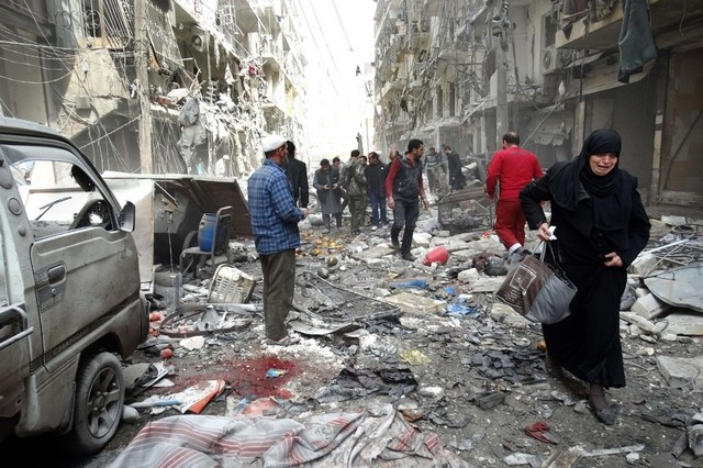 A Syrian woman cries as she leaves a residential block reportedly hit by an explosives-filled barrel dropped by a government forces helicopter on March 18, 2014, in Aleppo. Khaled Khatib / AFP
