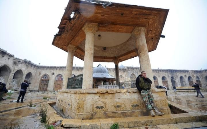 Forces loyal to Syria's President Bashar al-Assad stand inside the Umayyad mosque CREDIT: REUTERS