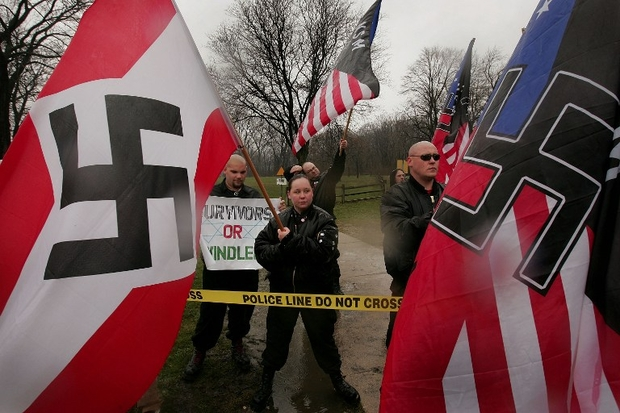 hoto: Neo-Nazi protestors organised by the National Socialist Movement demonstrate near the grand opening ceremonies were held for the Illinois Holocaust Museum and Education Center on 19 April 2009 (AFP)
