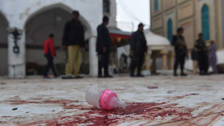 A baby's bottle lies on the blood-stained floor of the Sufi shrine of Lal Shahbaz Qalandar in Sehwan, Sindh Province, on February 17, a day after a bomb killed at least 70 people, including children, at the shrine. Pakistan cracked down nationwide soon after the blast, claimed by the 'Islamic State of Iraq and Syria' (ISIS). [Asif Hassan/AFP]