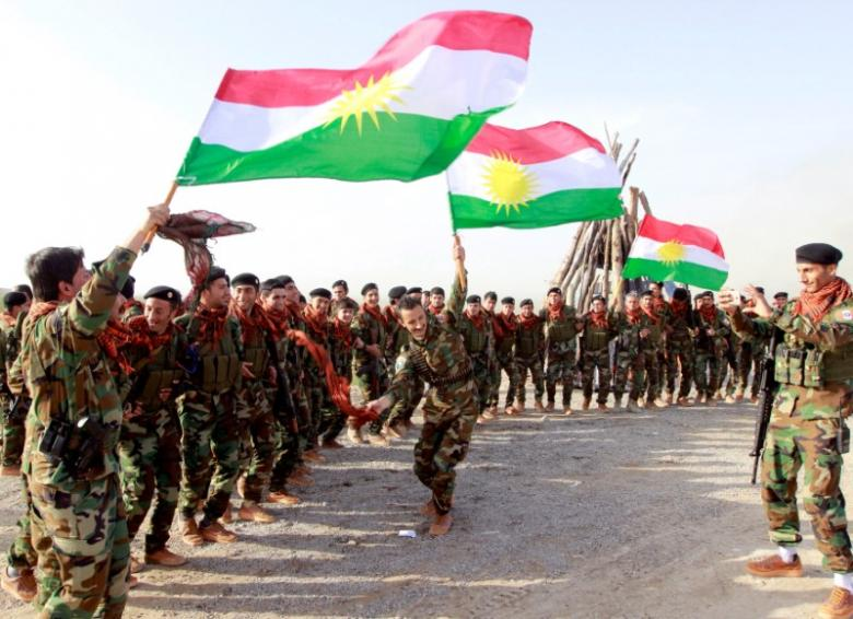 FILE PHOTO: Kurdish Peshmerga forces celebrate Newroz Day, a festival marking spring and the new year, in Kirkuk
