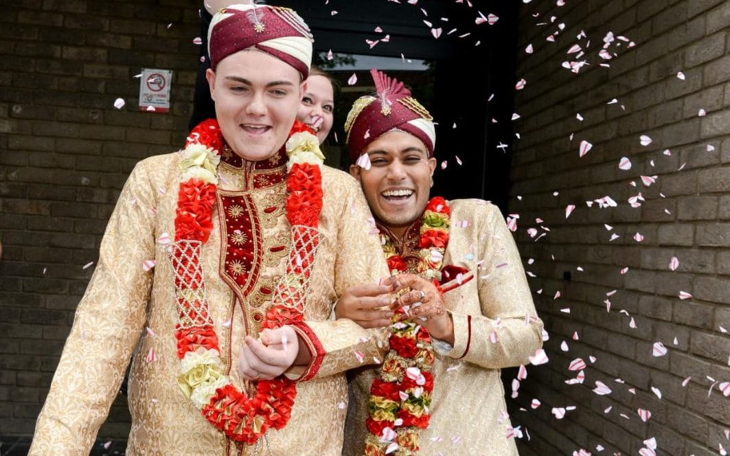 Happy grooms Jahed Choudhury, 24, and Sean Rogan, 19, who have been dating for two years, tied the knot wearing traditional golden Sherwanis in a civil ceremony at Walsall registry office - MPC Journal by Hakim khatib