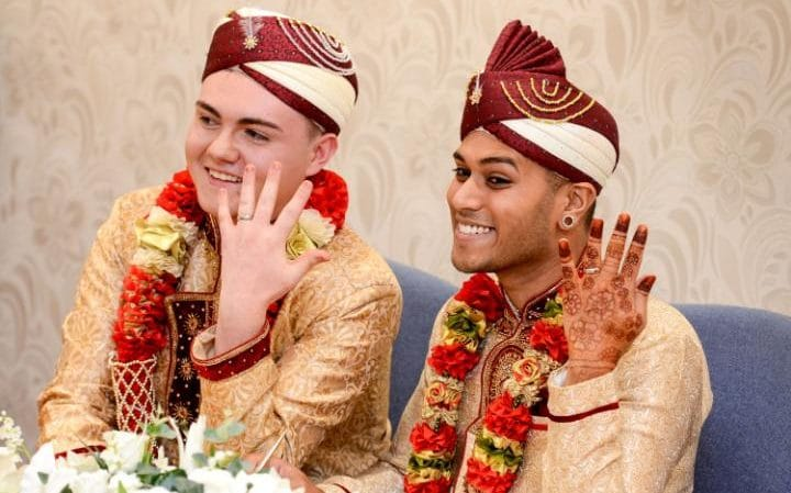 Showing off their rings, the couple pose for the cameras - First Gay Muslim Wedding Takes Place in the UK - MPC Journal