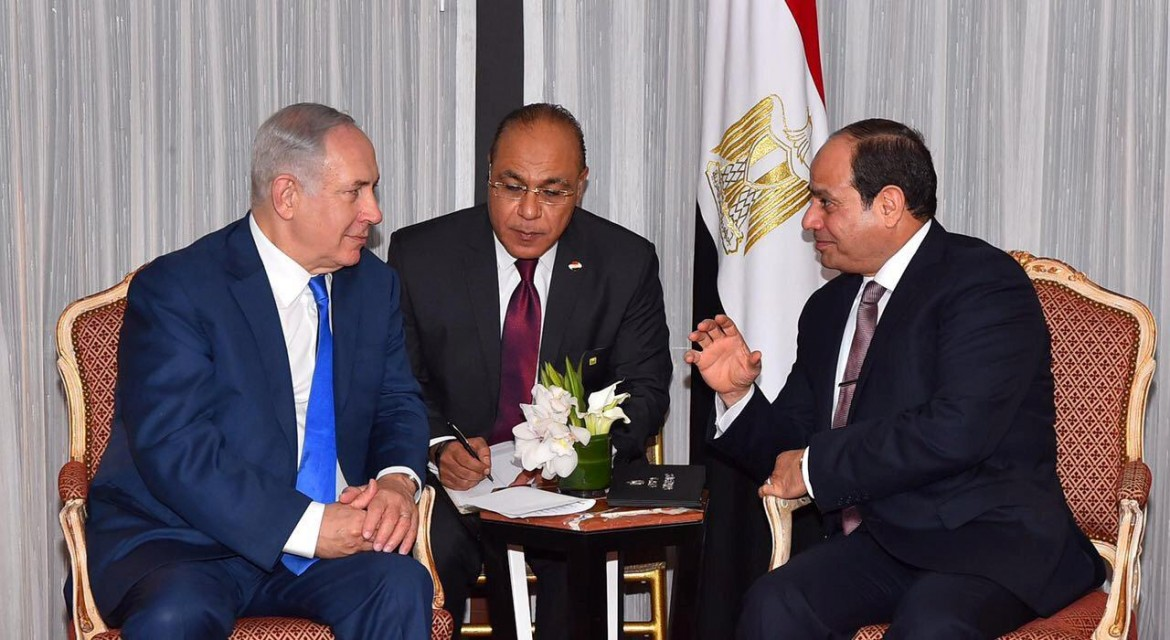 Egyptian President Abdel Fattah al-Sisi speaks with Israeli Prime Minister Benjamin Netanyahu during their meeting as part of an effort to revive the Middle East peace process ahead of the United Nations General Assembly in New York