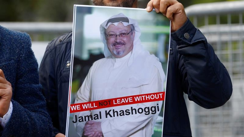 A demonstrator holds a picture of Jamal Khashoggi during a protest in front of Saudi Arabia's consulate in Istanbul [Osman Orsal/Reuters]