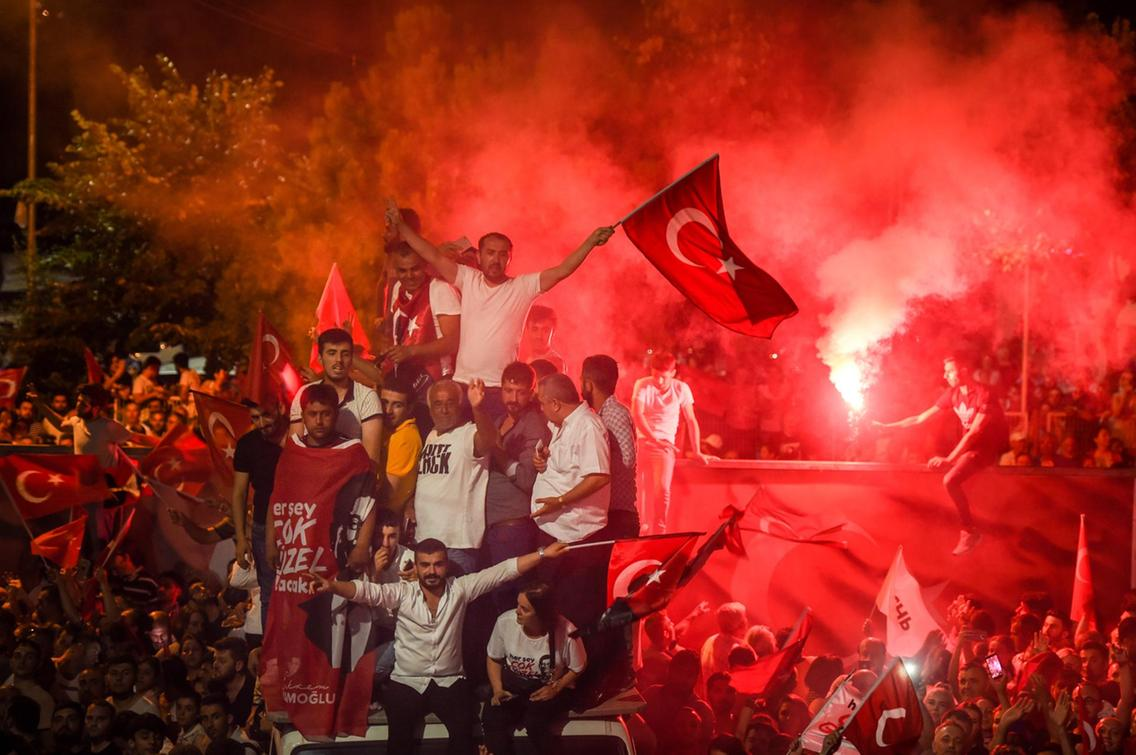 People celebrate after Binali Yildirim, who was favored by President Recep Tayyip Erdogan, conceded his defeat in the rerun of the mayoral election in Istanbul, Turkey. Burak Kara / Getty Images